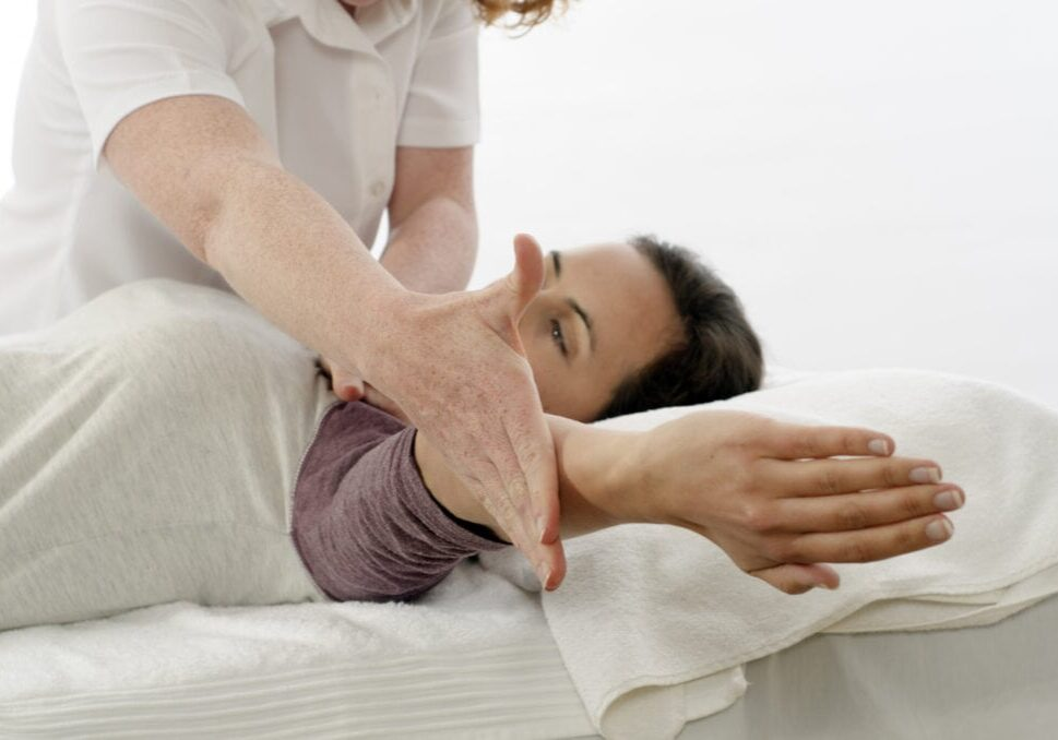 Kinesiologist or physiotherapist treating Trapezius